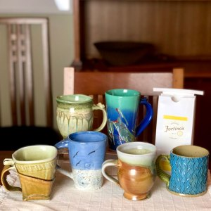Handmade ceramic mugs and coffee