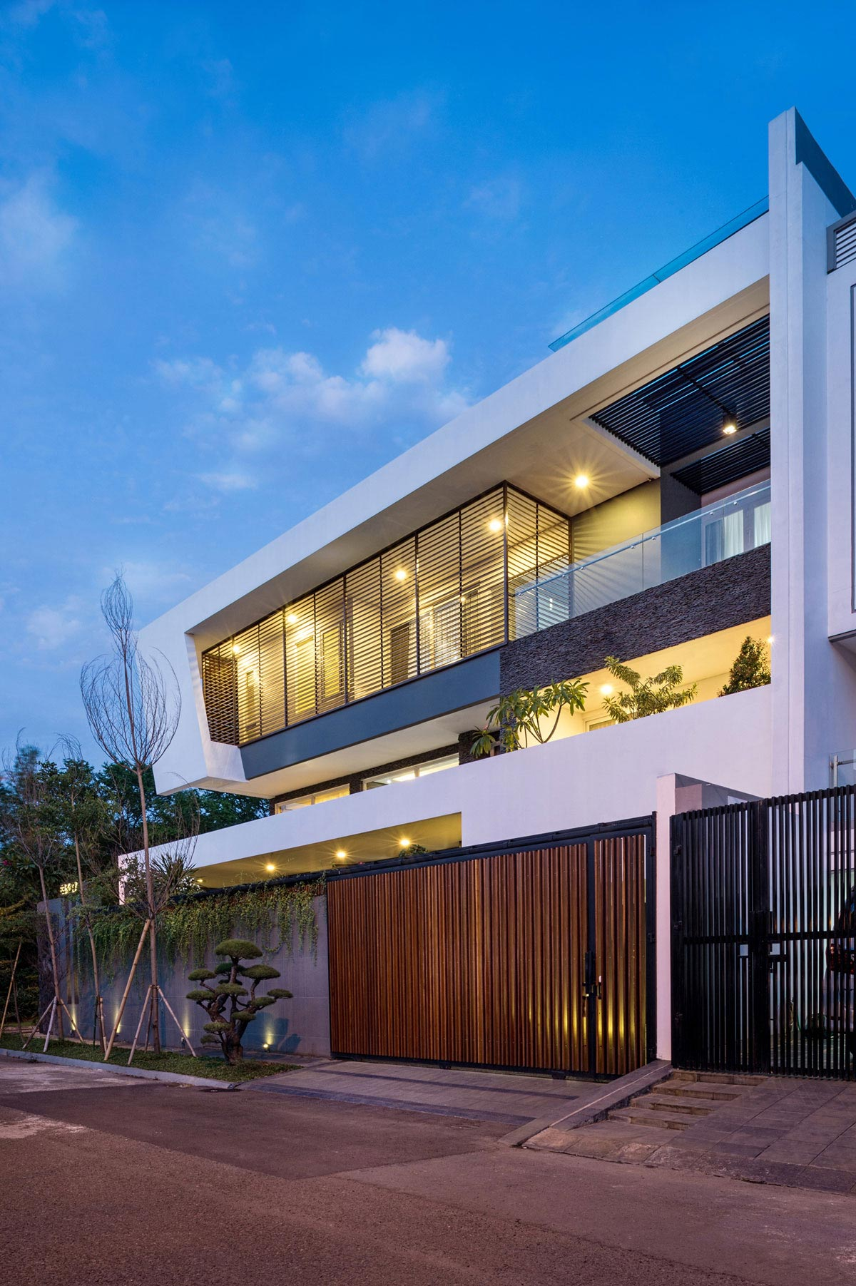 Tropical design approach of modern BM residence by DPHS Architects  CAANdesign  Architecture