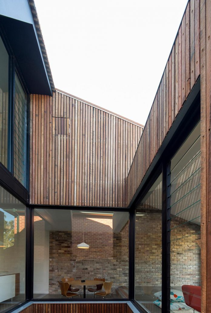 Cutaway Roof House a contemporary timber clad 2 storey addition by Scale Architecture