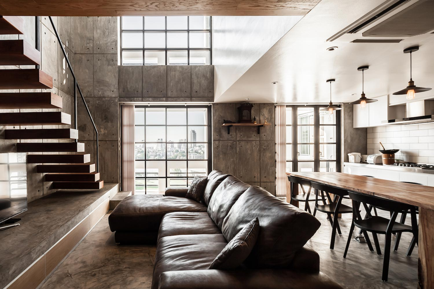 Contemporary Chefs two story apartment renovation by FATTSTUDIO  CAANdesign  Architecture and
