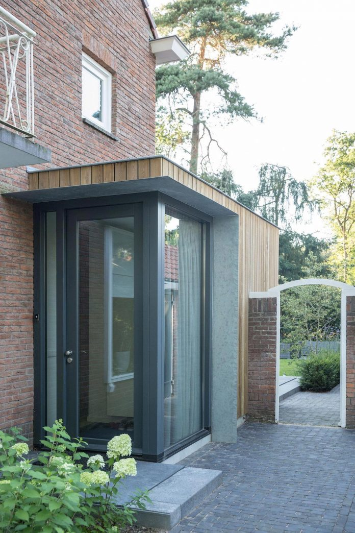 A timber clad extension creates a new relationship between a brick semidetached house and its