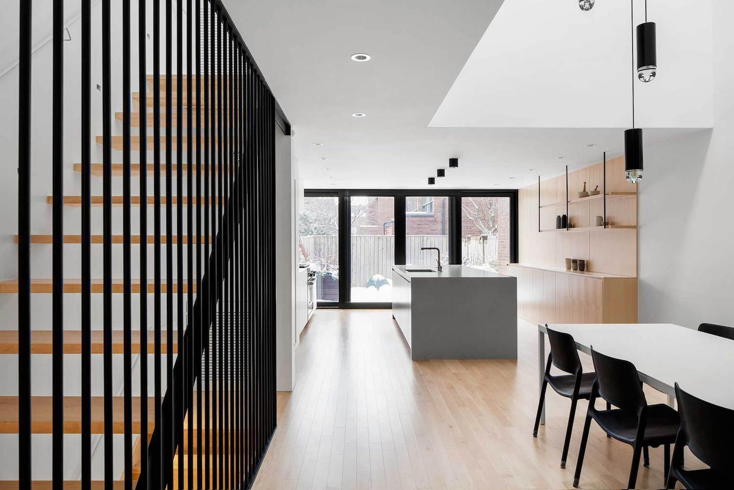 Somerville Residence by NatureHumaine renovation a row house with a tripleheight void topped