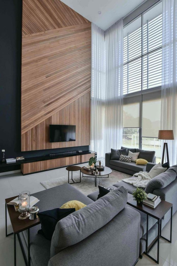 wood wall living room rustic colors for wil s 11 residence with a double volume feature matched sheer curtains