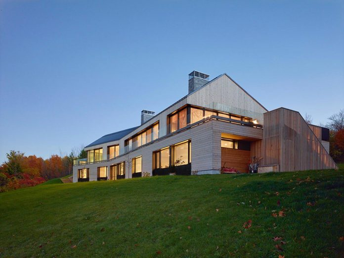 Contemporary interpretation of a traditional home inspired by the Long House typology