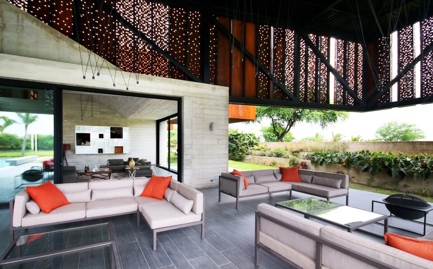 Exposed concrete for the first floor and a second floor covered in Corten steel panels with