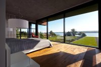 Modern brick house designed to offer spectacular lake ...