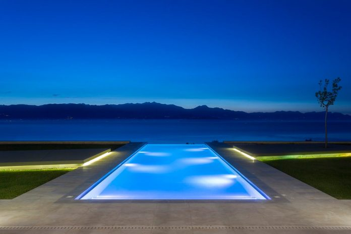 Two Storeys Villa In Greece With Large Openings On Both