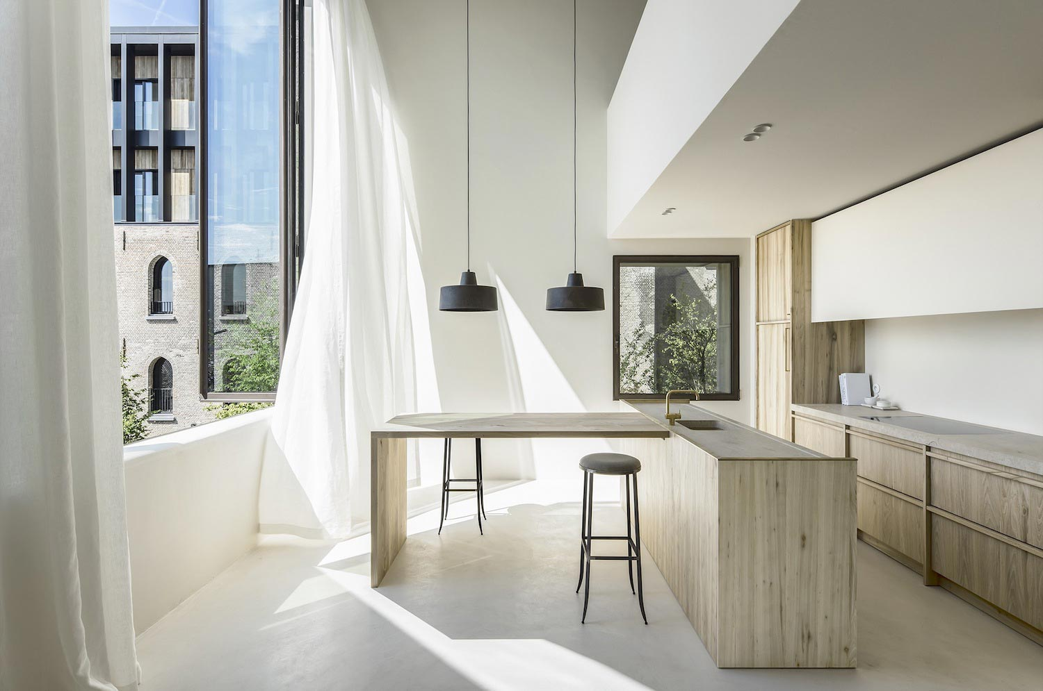 Minimalist interior design of the Cube Apartment designed by Arjaan De Feyter  CAANdesign