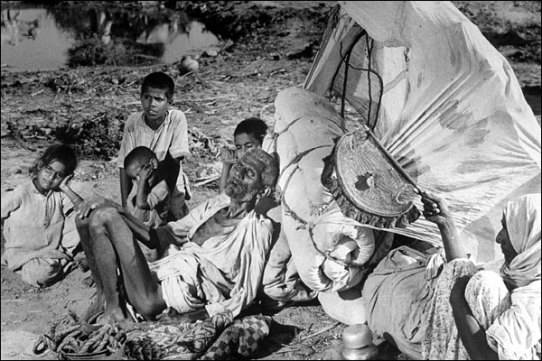"An aged and abandoned Muslim couple and their grand children sitting by the the roadside on this arduous journey. ""The old man is dying of exhaustion. The caravan has gone on,"" wrote Bourke-White. © BBC."