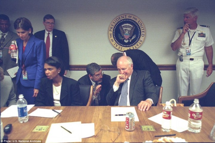 Official White House photographs taken on the morning of September 11, 2001, recently released by the National Archives show Dick Cheney in the in the President's Emergency Operations Center, located in a bunker under the White House. This is part of the Continuity of Government (COG) Network. He appears to be hiding a big fat grin.