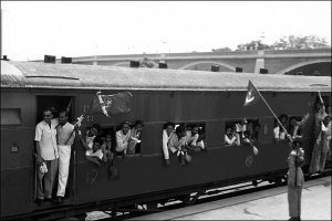 An obvious propaganda photo-op intended to encourage Indian Muslims to participate in the Partition. This image shows a special train leaving to Delhi for Pakistan on 9th August 1947. On board all Muslims who will be happily waving flags all the way to Pakistan. In reality, the train route was very unsafe and soon enough, trains drenched in blood were arriving in Pakistan. The British placed undue emphasis on the development of railways in India (as opposed to highways) as part of a future plan to transfer populations. In my book The World War Deception, we come across a similar parallel of the Germans developing railroads in the Ottoman Empire which were later used in the Armenian Holocaust. © Margaret Bourke-White.