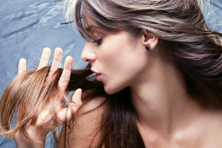 young brunette woman with nourished long  hair, studio shot, profile,