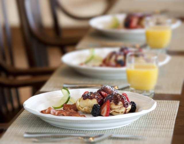 delicious cuisine wild berries breakfast desert with orange juice wedding planning