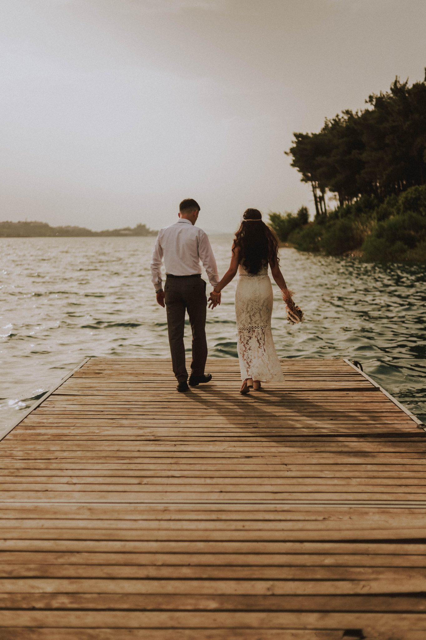 newly weds walking wedding venue