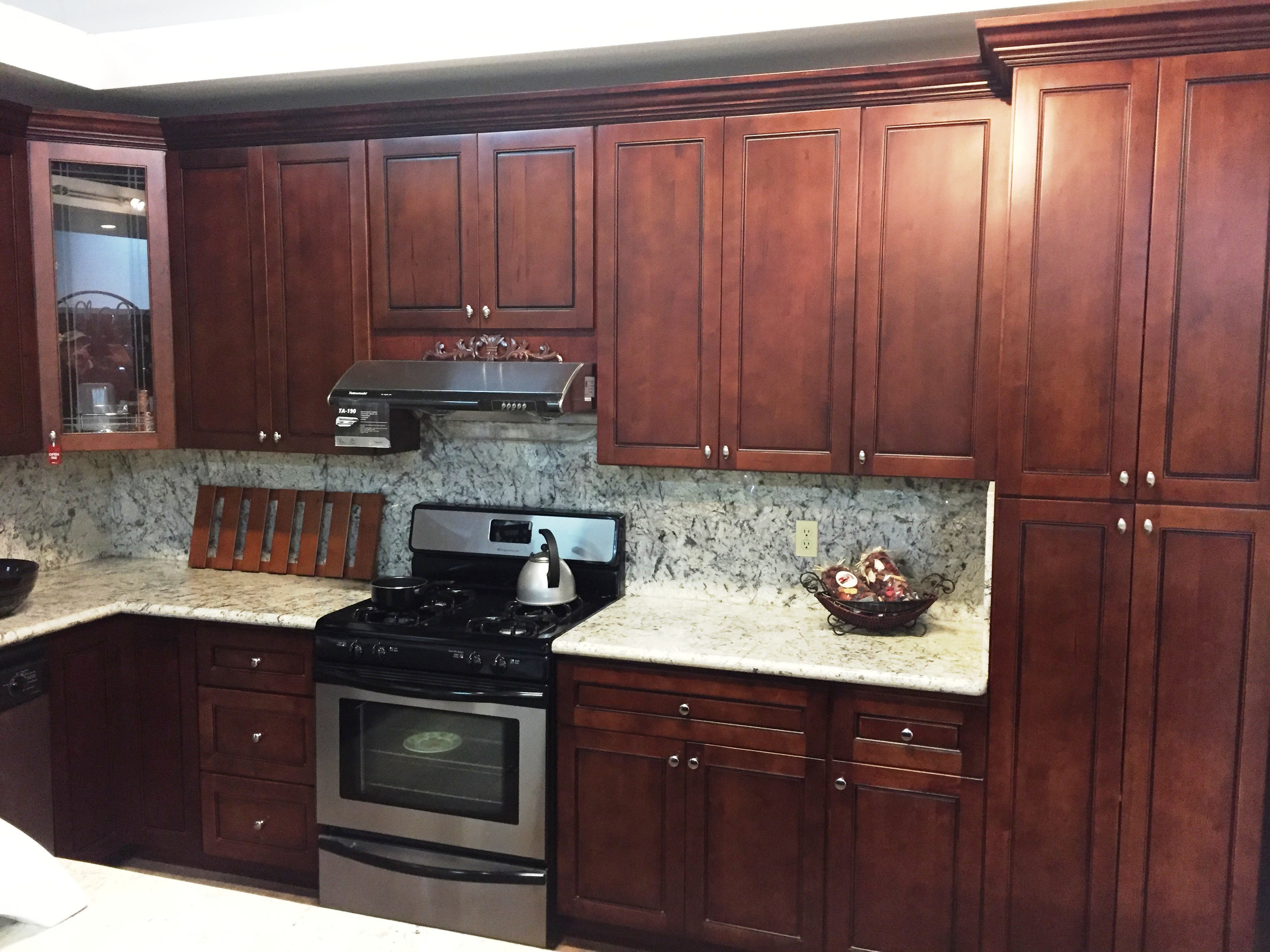 flat panel kitchen cabinets spices walnut colored maple