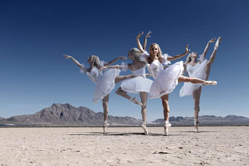 芭蕾舞女演员在干湖床上跳白色芭蕾舞裙