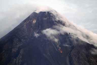 Mayon Volcano is seen emitting smoke in Albay province, Bicol region, south of Manila