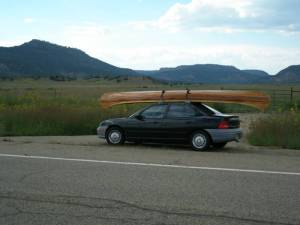 canoe carried on top of car