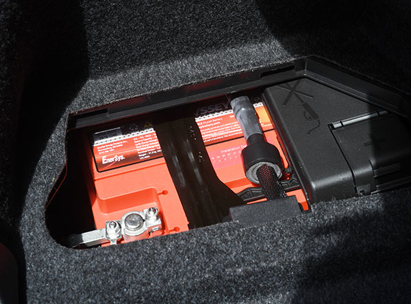 Once all the trunk trim is back in place with only the battery access panel removed, this is what you see. Good thing it's not the old days when people had to add water to batteries. Image: Author.