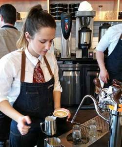 400 Fairview Caffe Ladro South Lake Union features a Modbar espresso brewing system and a barista pours a latte from it