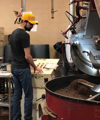 Ryan Rabaca Roasting whole bean coffee