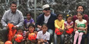 Jack Kelly in El Salvador watching children play with newly donated soccer balls