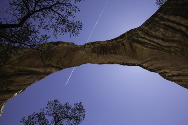 Jet trail over natural Bridge