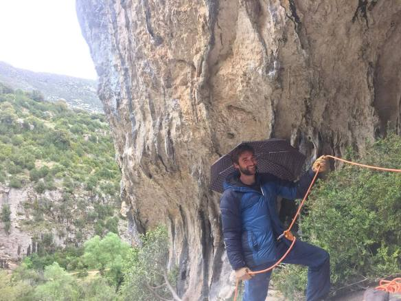 Essential belay equipment at a rainy Rodellar