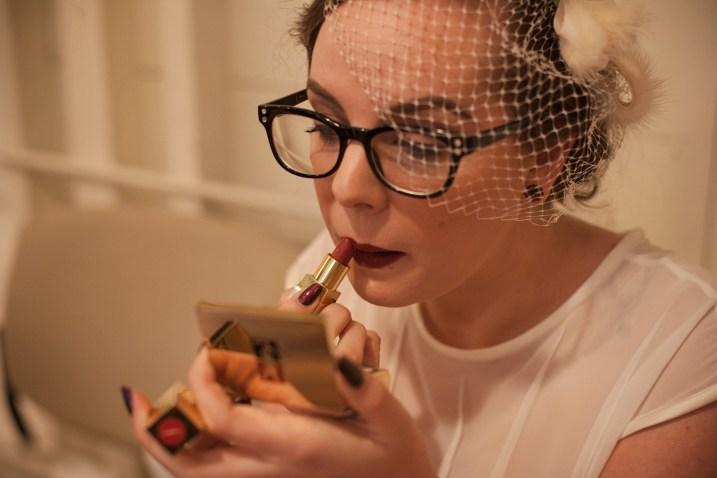 Spencer applying lipstick