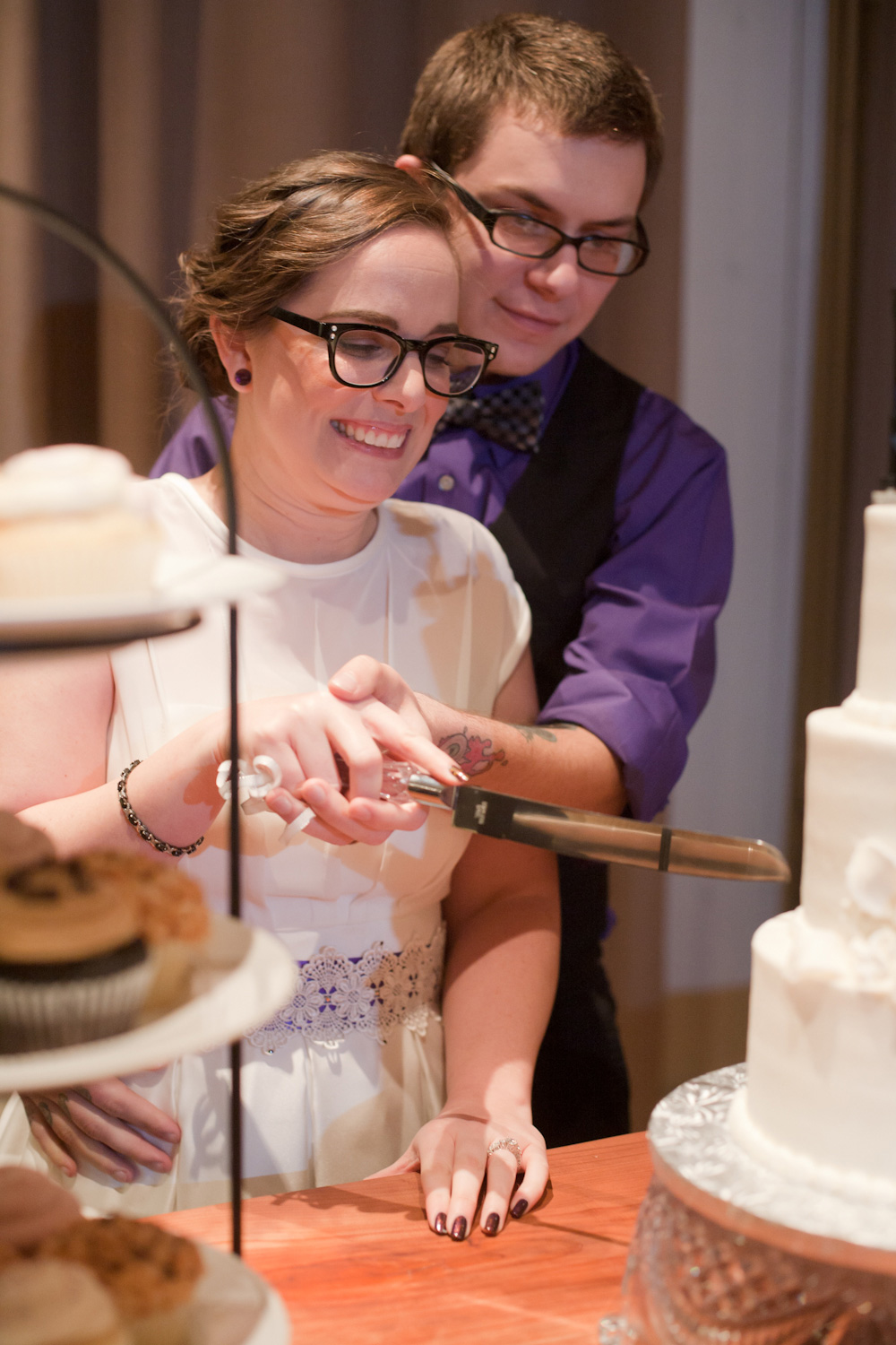 The bride and groom preparing to cut their wedding cake