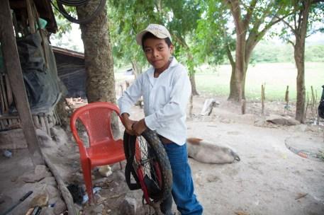 A young man repairs a bicycle tire in San Jose de las Lagrimas