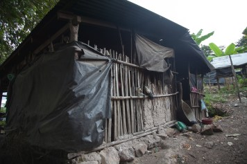 Houses in San Jose de las Lagrimas, Guatemala. All of the homes in this village are constructed from sticks, twine, and plastic sheeting with no weatherproofing, and no water or electricity.