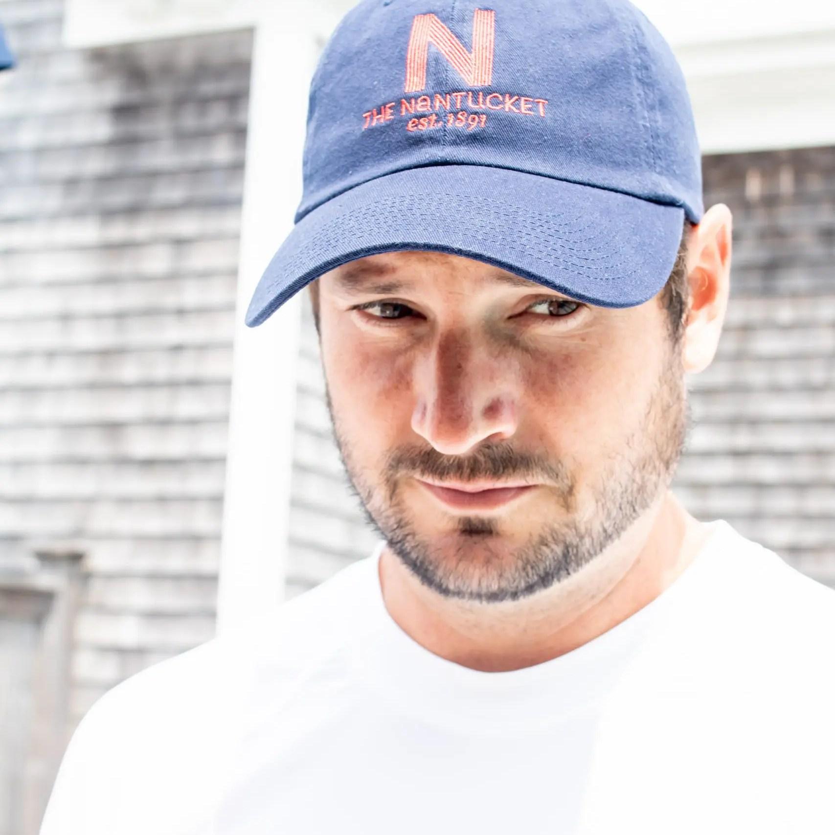 Man wearing Nantucket Hotel hat and Cabana Life sun safe shirt