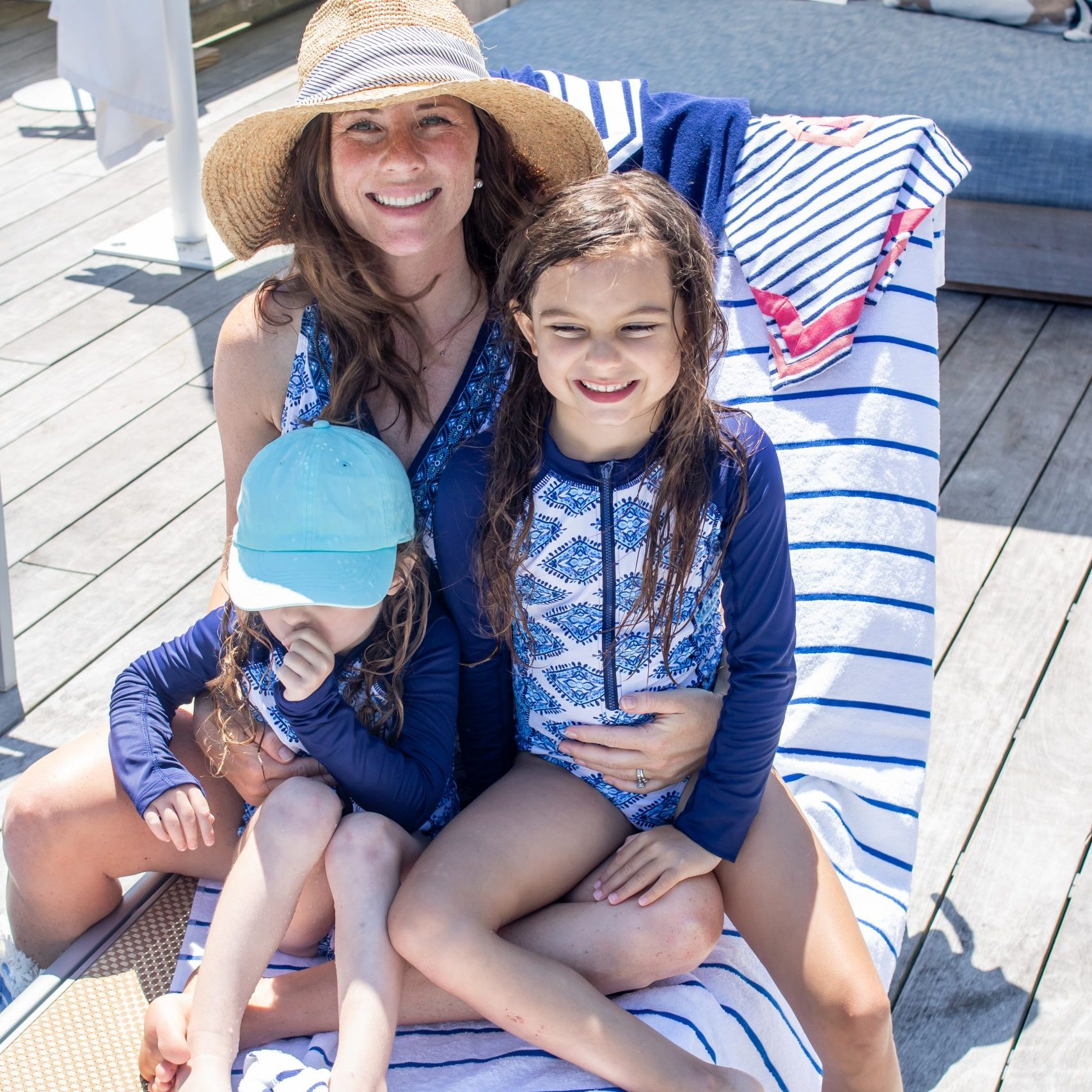 mom and daughters sitting poolside at The Nantucket