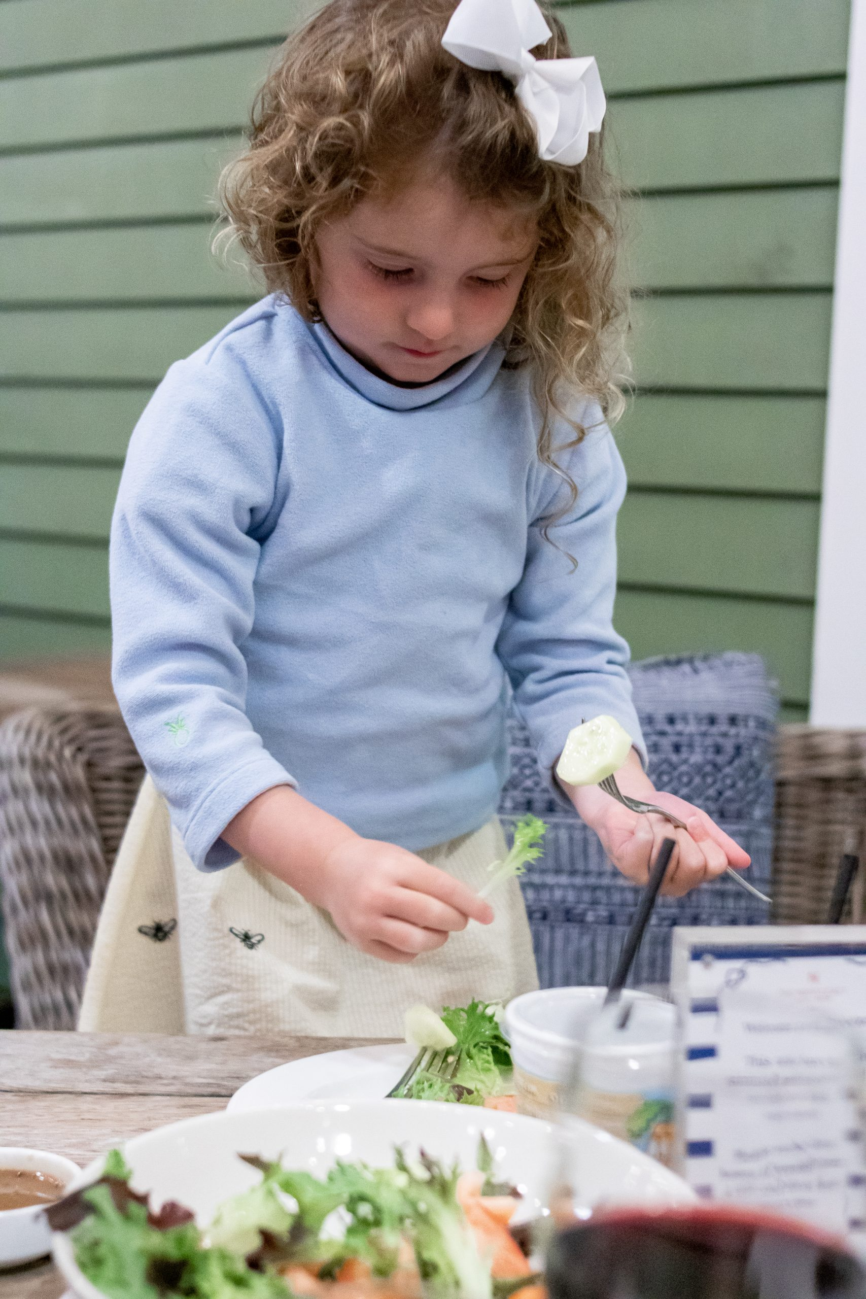 little girls eating salad at Breeze Nantucket