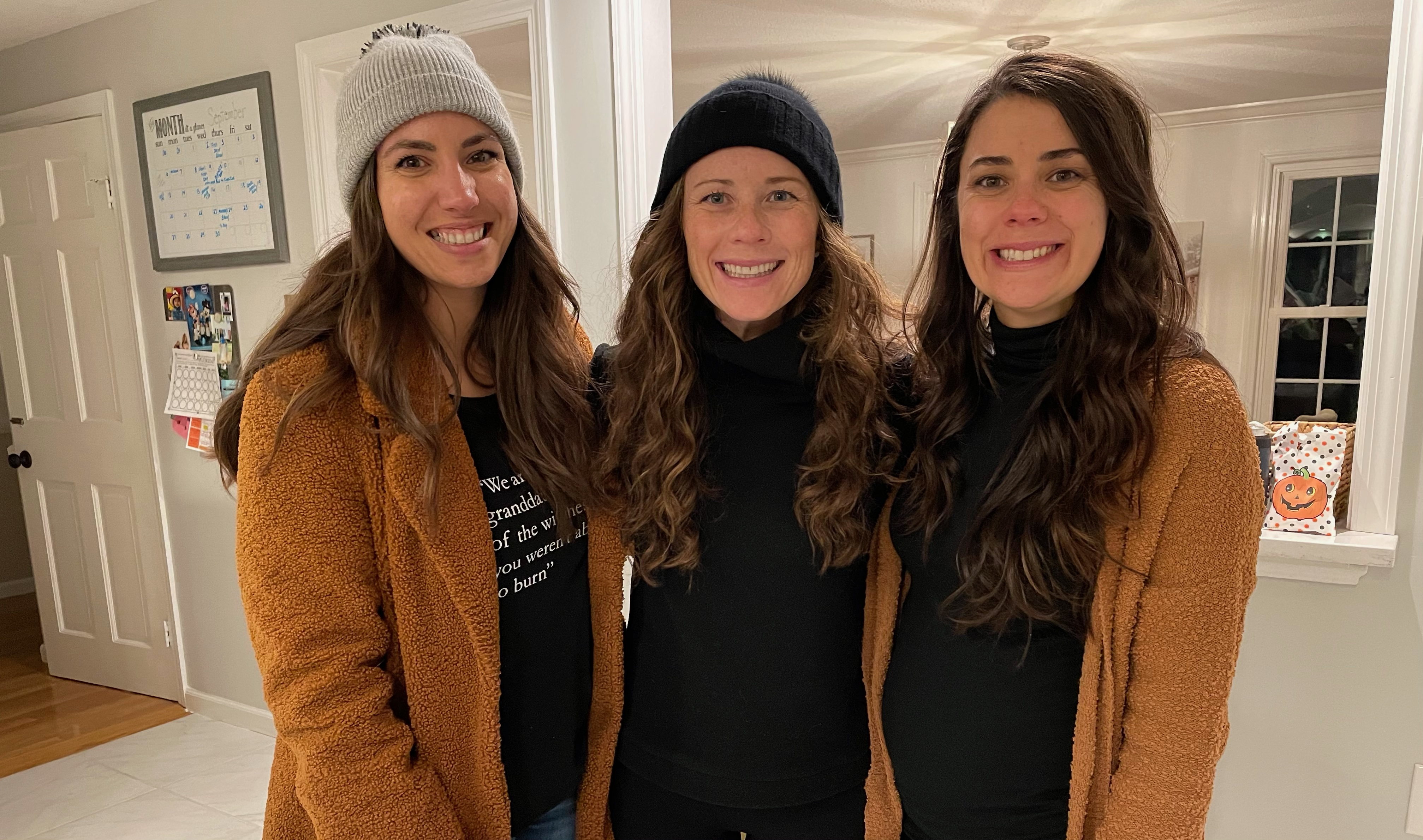 sisters in matching black and camel outfits