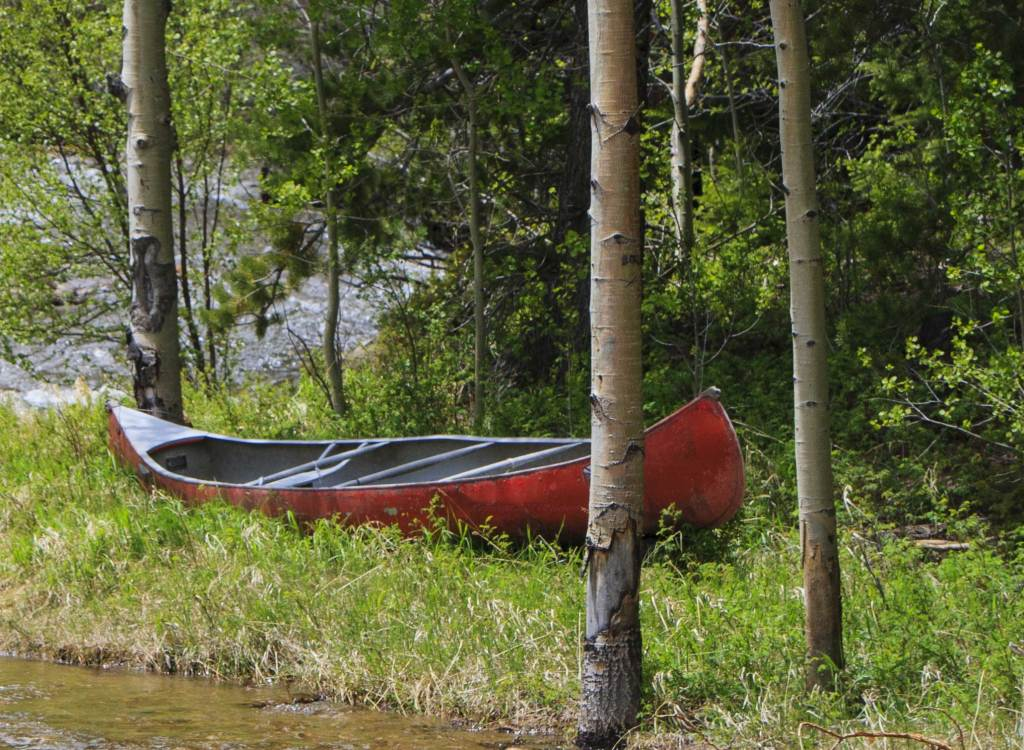 This canoe appeared to be abandoned on the side of the creek, waiting for someone to create memories in the Rocky Mountains. ...maybe a peaceful float on a calm stream, fly fishing for trout or a relaxing overnight camping trip. Next time, next trip!