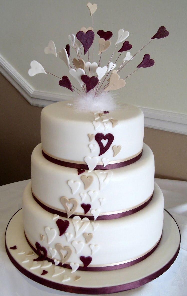 Wedding cake with purple hearts