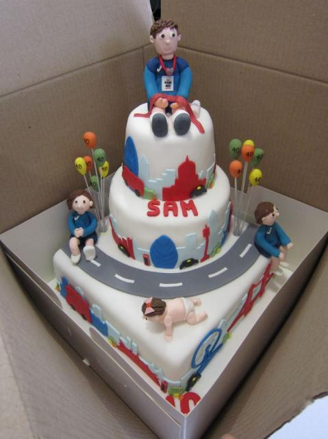 3 Tier Running Race Theme Cake With Winner Sitting On Top
