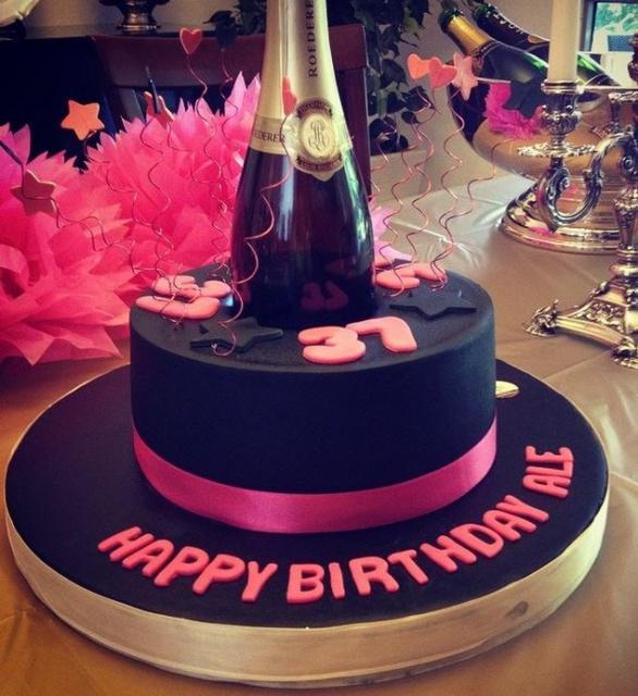 Black Birthday Cake With Champagne Bottle Topper JPG