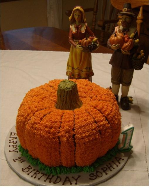Thanksgiving Birthday Cake With Pumpkin Shape And Figures