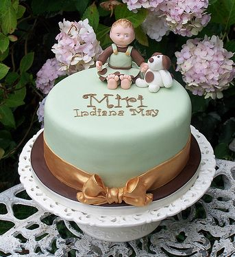 Light green Christening Cake with baby boy and a dog 1 comment