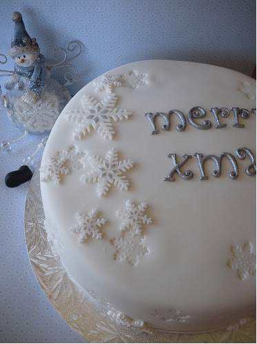 Modern Christmas cake in white with silver writing and snowflakes decorPNG 1 comment