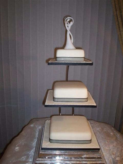 simple and elegant white wedding cake in square thin shape