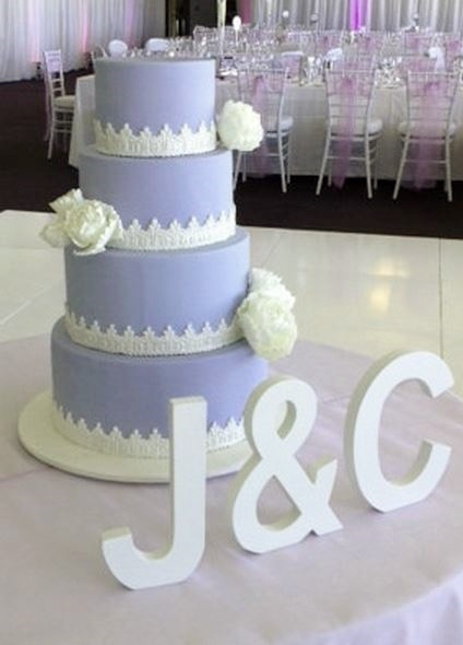Lavender Wedding Cake In 4 Tiers With White FlowersJPG