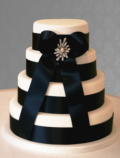 Four tier round white wedding cake with black ribbons and bowJPG 2 comments