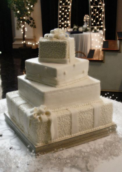 Four Tier Ivory Square Offset Wedding Cake With White Bows