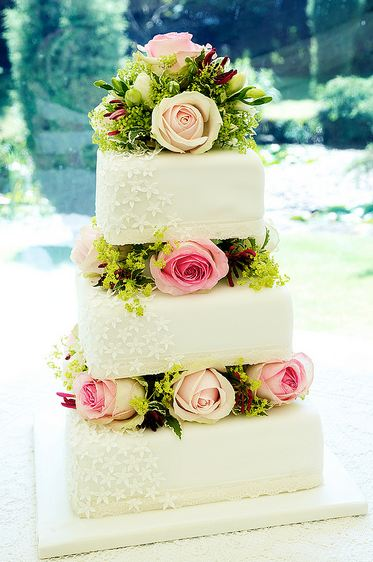 Three Tier Square White Wedding Cake With Roses In Between