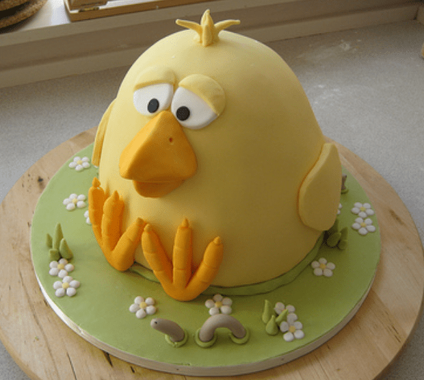 Gaint Easter Cake With Large Chick And A Worm On The Side Png