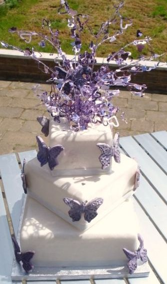 Three Tier Square White Weddign Cake With Lavender